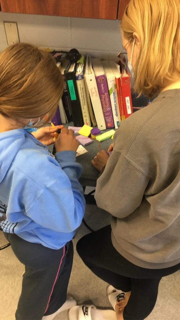 Riley and Lexi are hard at work on their robot!