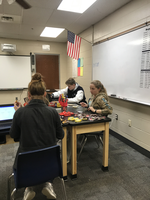 Entrepreneurship class creating candy bouquets to sell for Valentine's Day